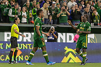 Portland, Oregon - Wednesday September 25, 2019: Jeremy Ebobisse #17 is congratulated by Diego Chara #21 after scoring a goal during a regular season game between Portland Timbers and New England Revolution at Providence Park on September 25, 2019 in Portland, Oregon.