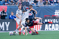 FOXBOROUGH, MA - JULY 25: Matt Polster #8 of New England Revolution collides with Lassi Lappalainen #21 of CF Montreal near the CF Montreal goal during a game between CF Montreal and New England Revolution at Gillette Stadium on July 25, 2021 in Foxborough, Massachusetts.