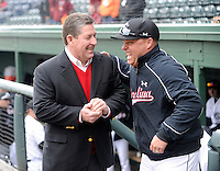 Athletics director Ray Tanner of the South Carolina Gamecocks, left, laughs with head coach Chad Holbrook prior to a game against the Clemson Tigers on Saturday, March 2, 2013, at Fluor Field at the West End in Greenville, South Carolina. Clemson won the Reedy River Rivalry game 6-3. (Tom Priddy/Four Seam Images)