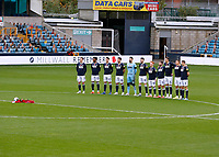 31st October 2020; The Den, Bermondsey, London, England; English Championship Football, Millwall Football Club versus Huddersfield Town; Millwall starting eleven stand while a member of the Armed Forces playing the bugle before kick off for Remembrance Sunday on the 11th November