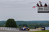 Alexander Rossi, Andretti Autosport Honda crosses the finish line under the checkered flag for the win