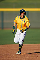 AZL Athletics Gold Yhoelnys Gonzalez (12) rounds the bases after hitting a home run in the first inning of an Arizona League game against the AZL Rangers on July 15, 2019 at Hohokam Stadium in Mesa, Arizona. The AZL Athletics Gold defeated the AZL Athletics Gold 9-8 in 11 innings. (Zachary Lucy/Four Seam Images)