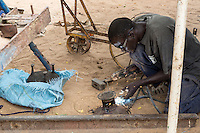 Welder Working in Blacksmith's Shop, Where Soil Rippers are Made, near Kaolack, Senegal. DOZENS MORE OF IMAGES RELATED TO MILLET CULTIVATION ARE AVAILABLE.  WHAT DO YOU NEED?