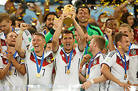 Miroslav Klose of Germany celebrates winning the FIFA World Cup trophy with team mates