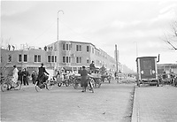 Photo from the NIOD's Huizinga collection. Residents load their contents on trucks in a demolished urban district along the coast due to the construction of the 'Atlantic Wall'. Menno Huizinga was part of the Hidden Camera and took pictures illegally during the occupation. He did this mainly in his hometown The Hague