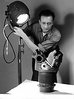 """A student at the School of Photography, NAS Pensacola, using a """"crosslight"""" which show texture or fractures of the casting to best advantage."""