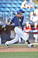 Asheville Tourists shortstop Carlos Herrera (4) swings at a pitch during a game against the Hagerstown Suns at McCormick Field on April 28, 2016 in Asheville, North Carolina. The Tourists were leading the Suns 6-5 when the game was delayed in the top of the 6th inning due to darkness. (Tony Farlow/Four Seam Images)
