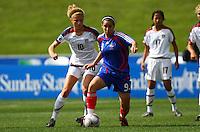 Pauline Crammer (FRA) and Kristie Mewis (USA)..FIFA U17 Women's World Cup, USA v France, Albany Stadium, Auckland, New Zealand, Wednesday 5 November 2008. Photo: Renee McKay/PHOTOSPORT