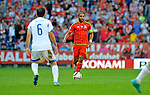 EURO 2016 QUALIFYING: WALES V ISRAEL AT CARDIFF CITY STADIUM : <br /> Welsh football Captain Ashley Williams takes the ball forward.<br /> <br /> EDITORIAL USE ONLY.