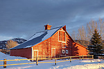 Gallatin County, Montana: Red barn with sunset light in winter