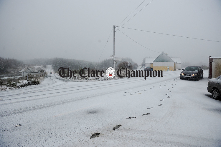 Snow begins to settle on the frozen surface at The Hand in West Clare on Tuesday evening. Photograph by John Kelly.