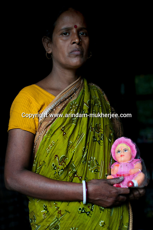 Jyotirmoyee Pal (37),  is a potter and produces colourful clay dolls. She expanded her business by taking micro credits from Bandhan. Ghurni village, Krishna Nagar, West Bengal, India. Arindam Mukherjee