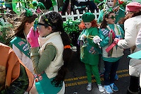 Members of a Girl Scout troop wait before the start of the parade to march in the 2013 annual St. Patrick's Day Parade in South Boston, Boston, Massachusetts, USA.
