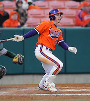 Wilson Boyd (12) hits in a game between the Charlotte 49ers and Clemson Tigers Feb. 20, 2009, at Doug Kingsmore Stadium in Clemson, S.C. (Photo by: Tom Priddy/Four Seam Images)