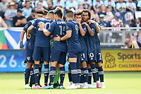 KANSAS CITY, KS - JUNE 26: Sporting KC players in pre game huddle during a game between Los Angeles FC and Sporting Kansas City at Children's Mercy Park on June 26, 2021 in Kansas City, Kansas.
