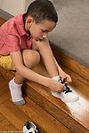 5 year old boy dressing self tying own shoe