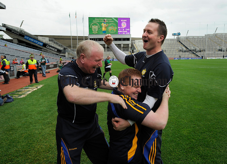 The brothers Hanley, Colm, the manager and Eogahan, trainer,  celebrate their win with selector John Nihill moments after the final whistle after the All-Ireland junior camogie final at Croke Park. Photograph by John Kelly.