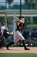 Pittsburgh Pirates third baseman Patrick Dorrian (67) follows through on a swing during a Florida Instructional League game against the Detroit Tigers on October 2, 2018 at the Pirate City in Bradenton, Florida.  (Mike Janes/Four Seam Images)