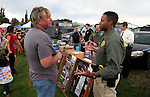 CCSO Dep. T.J. Boggan talks with Shawn McConnell at the SWAT booth at the 11th annual National Night Out hosted by the Carson City Sheriff's Office in Carson City, Nev., on Tuesday, Aug. 6, 2013. <br />