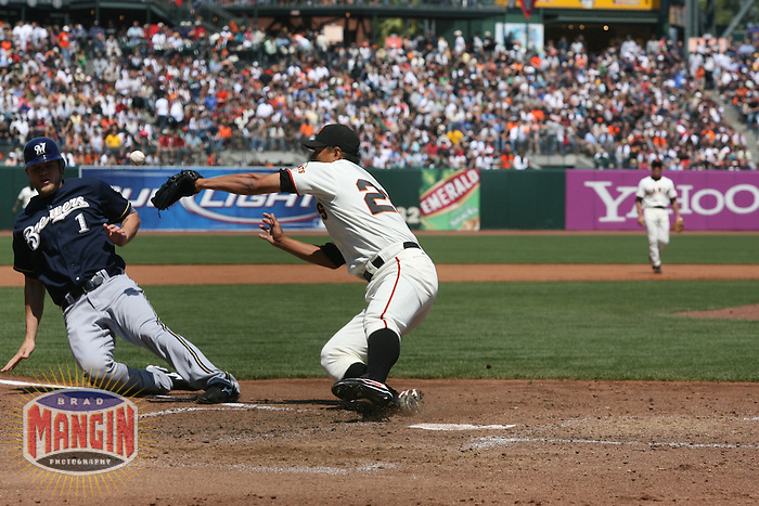 SAN FRANCISCO - JULY 19:  Corey Hart of the Milwaukee Brewers slides home safely as San Francisco Giants pitcher Keiichi Yabu drops the ball at home plate during their game at AT&T Park in San Francisco, California on July 19, 2008.  The Brewers defeated the Giants 8-5.  Photo by Brad Mangin