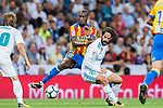 Geoffrey Kondogbia (l) of Valencia CF battles for the ball with Isco Alarcon of Real Madrid during their La Liga 2017-18 match between Real Madrid and Valencia CF at the Estadio Santiago Bernabeu on 27 August 2017 in Madrid, Spain. Photo by Diego Gonzalez / Power Sport Images