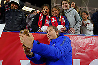 CARSON, CA - FEBRUARY 7: Tobin Heath #17 of the United States takes a selfie with fans during a game between Mexico and USWNT at Dignity Health Sports Park on February 7, 2020 in Carson, California.