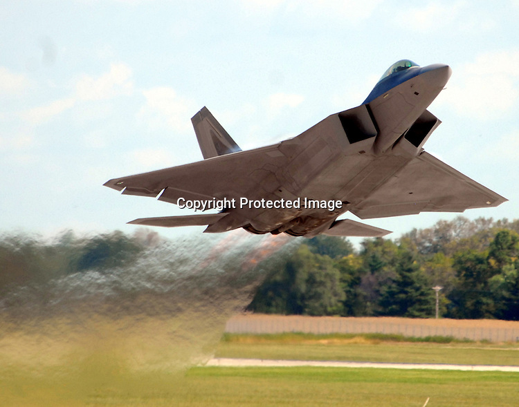 Staff Photo/Mike Ullery.An F-22 Raptor takes to the sky at Rickenbacker Air National Guard Base near Columbus to fly a demonstration at the Gathering of Mustangs and Legends.