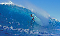 Surfer riding a wave at Velzyland, North Shore of Oahu
