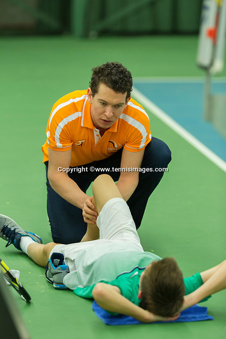 Rotterdam, The Netherlands, March 13, 2016,  TV Victoria, NOJK 12/16 years, Sander Jong (NED) is being  treated for a foot injury by fysio Ceasar<br /> Photo: Tennisimages/Henk Koster