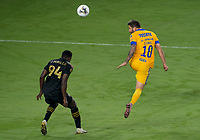 22nd December 2020, Orlando, Florida, USA;  Tigres Andre-Pierre Gignac (10)heads the ball during the Concacaf Champions League Final between the LAFC and Tigres on December 22, 2020 at Explorer Stadium in Orlando, FL.