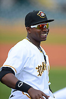 Bradenton Marauders outfielder Gregory Polanco #25 stretches before a game against the Fort Myers Miracle at McKechnie Field on April 7, 2013 in Bradenton, Florida.  Fort Myers defeated Bradenton 9-8 in ten innings.  (Mike Janes/Four Seam Images)