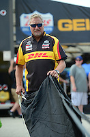 Jun. 30, 2012; Joliet, IL, USA: NHRA funny car driver Jeff Arend packs his parachutes during qualifying for the Route 66 Nationals at Route 66 Raceway. Mandatory Credit: Mark J. Rebilas-