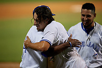 Dunedin Blue Jays Ryan Noda (19) celebrates with manager Cesar Martin (14) after hitting a walk off grand slam home run in the bottom of the ninth inning during a Florida State League game against the Jupiter Hammerheads on May 15, 2019 at Jack Russell Memorial Stadium in Clearwater, Florida.  Dunedin defeated Jupiter 8-4 in nine innings, the second game of a doubleheader.  (Mike Janes/Four Seam Images)