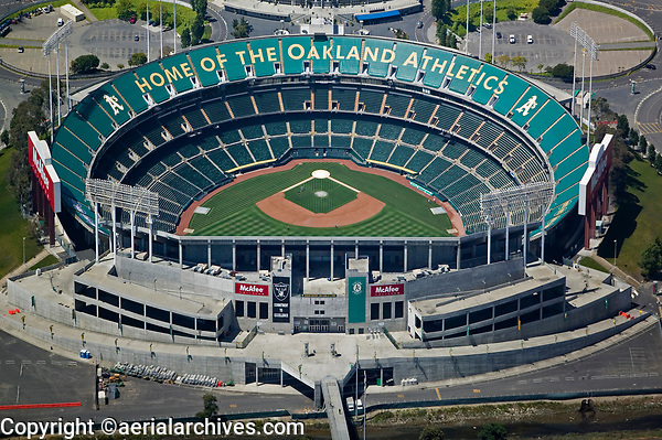 aerial photograph of a few members of the Oakland Athletics baseball team training in the virtually empty McAfee Oakland Coliseum, Oakland, California