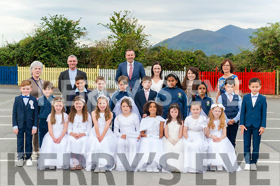 St Olivers NS, Killarney pupils after receiving their First Holy Communion in the Church of Resurrection, Killarney last  Saturday pictured at the school. front l-r Naoise O'Keeffe, Ava Price, Clodagh Donnelly, Frankie Tracey, Flody Walsh, Isabel Ling, Roisin O'Donoghue and Aiste Aronminte, back l-r Finn O'Leary, Obada Saleh, Santiago Henriques, Fionn Horgan, Ayrton McGough, Brian, Slabys, Drisanna Kotowaroo, Tahira Zaman, Brian O'Connor and Ralph Penggai and their teachers l-r Elizabeth O'Doherty, Fr Niall Howard, Principal Rory Darcy, Susanne O'Neill, Anne O'Neill and Leana O'Brian.