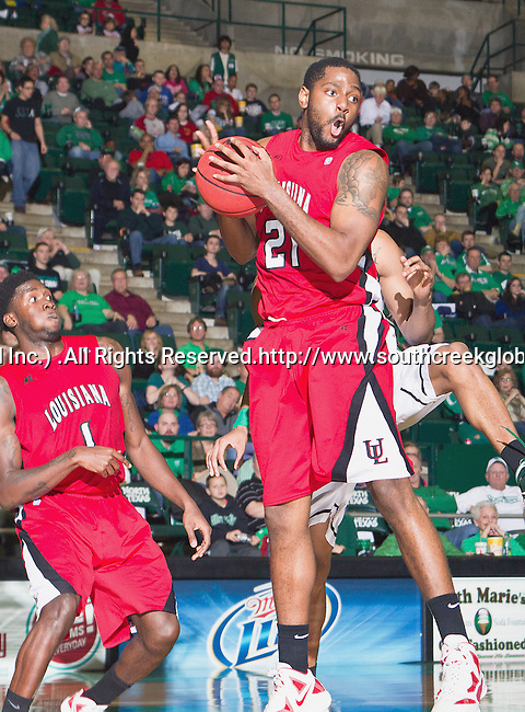 Louisiana Lafayette Ragin Cajuns forward Darshawn McClellan (21) and Louisiana Lafayette Ragin Cajuns guard Josh Brown (1) in action during the game between the Louisiana Lafayette Ragin Cajuns and the University of North Texas Mean Green at the North Texas Coliseum,the Super Pit, in Denton, Texas. Louisiana Lafayette defeats UNT 57 to 53.