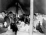 Gettysburg PA: View of te McKeesport Boy's Brigade eating dinner while camping at Gettysburg. Brady Stewart was in Gettysburg with the Pittsburgh-area Boy's Brigade. They were in Gettysburg for 40th anniversary of the battle of Gettysburg. The Boy's Brigade was a church-based youth organization started in the late 1800s in Scotland.