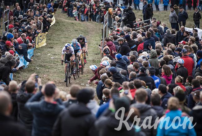 Wout Van Aert (BEL/Cibel-Cebon Offroad Team), Michael Vanthourenhout (BEL/Marlux Bingoal) and later race winner Toon Aerts (BEL/Telenet Fidea Lions) cheered on by the crowd.<br /> <br /> Koppenbergcross Belgium 2018