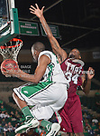 North Texas Mean Green guard Jordan Williams (23) and Troy Trojans forward Ray Chambers (34) in action during the game between the Troy Trojans and the University of North Texas Mean Green at the North Texas Coliseum,the Super Pit, in Denton, Texas. UNT defeats Troy 87 to 65.....