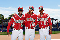 Batavia Muckdogs Samuel Castro (25), Jhonny Santos (32), and Pablo Garcia (7) after the team photo before a game against the Aberdeen Ironbirds on July 15, 2016 at Dwyer Stadium in Batavia, New York.  Aberdeen defeated Batavia 4-2. (Mike Janes/Four Seam Images)
