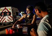 """Una joven voluntaria sirve de tomar a un migrante.<br /> <br /> Migrantes reciben atención medica, alimentación, aseo personal y un lugar para descansar en el comedor Comunitario de la Colonia San Luis de Hermosillo Sonora.<br /> <br /> La Caravana del Migrante con un contingente de alrededor de 600 personas en su mayoría de origen centroamericano, arribo a Hermosillo Sonora a bordo del tren conocido como """"La Bestia"""", provienen de la frontera Sur del País y con rumbo a la ciudad de Mexicali donde continuaran el viaje hasta Tijuana.<br /> La caravana tiene como objetivo solicitar <br /> asilo a Estados Unidos y algunos integrantes piensan solicitar una visa humanitaria en México para laborar en los campos de Sonora y Baja California.<br /> (Photo: NortePhoto/Luis Gutiérrez)"""