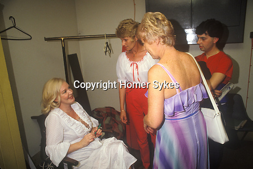 """Kathy Kirby pop singer from the 1960s to 1980s, her """"Come Back"""" tour Patti Pavilion, Swansea Wales 1983. 1980s In her dressing room after the show with fans."""