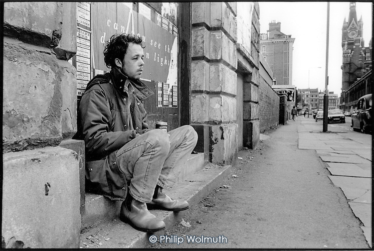 Young homeless man in Pancras Road, King's Cross, 1989.