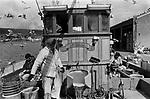Gutting fish by hand. Lerwick fishing industry. Shetland Island 1970s UK