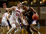 SIOUX FALLS, SD - MARCH 6: Tamell Pearson #2 of the Western Illinois Leathernecks looks to make a move against Tasos Kamateros #34 of the South Dakota Coyotes during the Summit League Basketball Tournament at the Sanford Pentagon in Sioux Falls, SD. (Photo by Dave Eggen/Inertia)