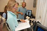 Earthwatch Sea Otter Team Looking at Animal Skelatal Book
