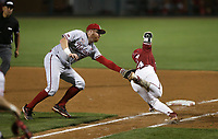 Nebraska Luke Roskam (25) forces out Arkansas infielder Cullen Smith (14), Saturday, June 5, 2021 during the eighth inning in the second game of the NCAA Fayetteville Regional at Baum-Walker Stadium in Fayetteville. Check out nwaonline.com/210606Daily/ for today's photo gallery. <br /> (NWA Democrat-Gazette/Charlie Kaijo)