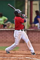 Elizabethton Twins right fielder Jeremias Pineda #5 swings at a pitch during a game against the  Bristol Pirates at Joe O'Brien Field June 30, 2014 in Elizabethton, Tennessee. The Twins defeated the Pirates 8-5 in game one of a double header. (Tony Farlow/Four Seam Images)