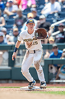 Michigan Wolverines first baseman Jimmy Kerr (15) makes a catch during Game 11 of the NCAA College World Series against the Texas Tech Red Raiders on June 21, 2019 at TD Ameritrade Park in Omaha, Nebraska. Michigan defeated Texas Tech 15-3 and is headed to the CWS Finals. (Andrew Woolley/Four Seam Images)