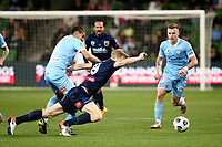 22nd May 2021, Melbourne, Australia;  Matt Simon of the Central Coast Mariners is held off the ball during the Hyundai A-League football match between Melbourne City FC and Central Coast Mariners at AAMI Park in Melbourne, Australia.